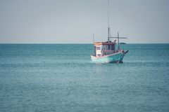 Beautiful seascape view of fishing boat floating on the sea. Selective focus Stock Images