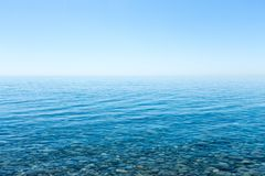 Beautiful seascape with a view of the horizon and a cloudless sky. Royalty Free Stock Images