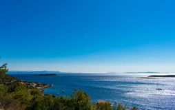 View of a sun rising above islands in the Adriatic sea in Croatia royalty free stock images