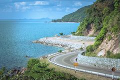 Beautiful Seascape Viewpoint of the road beside blue sea that is landmark at Kung Wiman Bay in Chanthaburi Province. stock photos