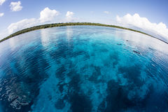 Beautiful Seascape in Wakatobi. Clear, warm water covers a coral reef in Wakatobi National Park, Indonesia. This remote, tropical region south of Sulawesi is Stock Photo