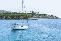 Beautiful seascape with white sailing yacht in the blue sea. Lowered the sails, calm. The concept of stagnation, no purpose, dropp Royalty Free Stock Photos