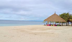 Beautiful seascape of white sand beach with colorful seats in the nice gazebo in cloudy day at Bohol island, Philippines royalty free stock photos