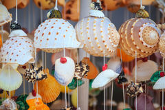 Beautiful seashell mobile hanging in the shop for sale. Handicrafts produced by the shell wall, souvenirs from the seaside. royalty free stock photo