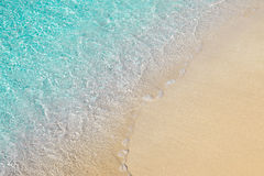 Beautiful seashore with clear transparent blue water and sand Royalty Free Stock Photography