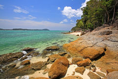 Beautiful seashore with colorful rocks against blue sky Royalty Free Stock Photos
