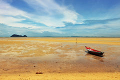 Beautiful seashore during low tide. Seascape in Thailand with fisherman boat during low tide Royalty Free Stock Photo