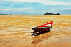 Beautiful seashore during low tide. Seascape in Thailand, ooh Phangan, with fisherman boat during low tide Royalty Free Stock Photography