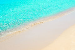 Beautiful seashore with sand, transparent blue sea water Royalty Free Stock Image