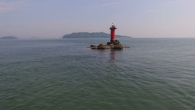 Beautiful seaside with lighthouse stock video footage