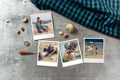 Beautiful seaside snapshots arranged on rustic wooden background with seashells around Royalty Free Stock Photography
