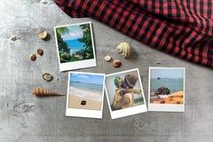 Beautiful seaside snapshots arranged on rustic wooden background with seashells around Stock Photography