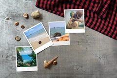 Beautiful seaside snapshots arranged on rustic wooden background with seashells around Royalty Free Stock Image