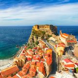 Beautiful seaside town village Scilla with old medieval castle on rock Castello Ruffo royalty free stock photography