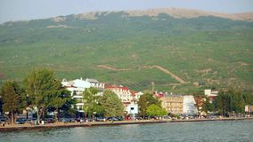 Beautiful seaside view of Ohrid town and the Ohrid lake. Ohrid is fa. Ohrid town seaside and Ohrid lake. Ohrid is famous for its unesco listed historical center stock footage