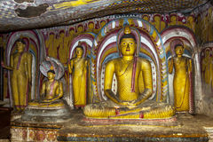 A beautiful seated Buddha statue inside the Dambulla Cave Temples in central Sri Lanka. Stock Photography