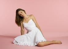 Beautiful seated woman stock photo