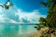 Beautiful seaview on island Brac in Croatia with yacht. View on Zlatni Rat or Golden Cape beach Stock Photos
