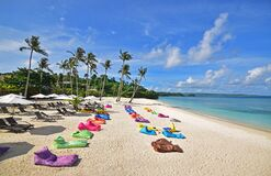Ilig Iligan Beach in the Western Visayas, Philippines with large colourful bean bags with few tourists during the covid19 pandemic