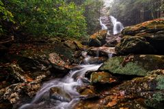 Beautiful Secluded Waterfall. Lower Bubbling Spring Branch Falls in North Carolina. A very beautiful 20 foot waterfall near the Blue Ridge Parkway. Seen here in stock photo