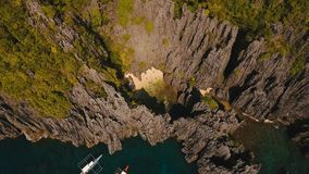 Beautiful secret tropical lagoon, aerial view. Tropical island. Secret lagoon. Tropical lagoon with turquoise water and white sand. Blue Lagoon with tourists stock video footage