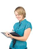 The beautiful secretary. The beautiful girl writes in the daily log Royalty Free Stock Images