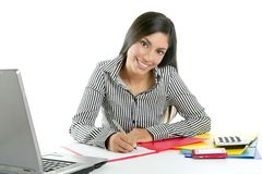 Beautiful secretary businesswoman writing on desk Stock Images