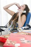 Beautiful secretary eating sweets Royalty Free Stock Images