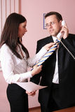 Beautiful secretary helping businessman with his t Stock Photo