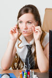 Beautiful secretary in an office environment. Royalty Free Stock Photography