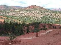 Beautiful Sedona II. Red and green Sedona desert mountain view against a bright cloudy sky Royalty Free Stock Images