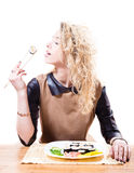 Beautiful seductive blond woman with curly hair eating sushi with chopsticks & great pleasure isolated on white background Royalty Free Stock Photos