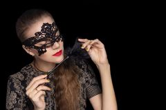 Beautiful seductive girl in a black lace mask stock images