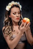 Beautiful seductive woman with apple Royalty Free Stock Image