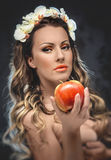 Beautiful seductive woman with apple Stock Photography