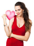 Beautiful seductive woman holding red love heart. Royalty Free Stock Images