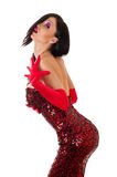 Beautiful seductive woman in red dress with sequins Stock Photos
