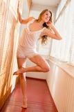 Beautiful Seductive Young Woman In Pajamas Having Fun Posing Looking Up On Balcony Looking Through Shutters Light Stock Photos
