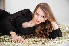 Beautiful seductive young woman with long curly hair Royalty Free Stock Image