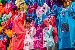 A traditional Mexican clothing in Nuevo Progreso, Mexico. A beautiful selections of local Mexican souvenir objects to be founded in Nuevo Progreso stock photography