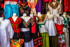 A traditional Mexican clothing in Nuevo Progreso, Mexico. A beautiful selections of local Mexican souvenir objects to be founded in Nuevo Progreso royalty free stock images