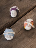 Beautiful selfmade easter eggs. Three selfmade easter eggs sticked with newspaper on a wooden table Stock Photos