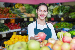 Beautiful sellers apples stacked on the counter Royalty Free Stock Image