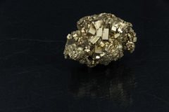 Beautiful semi-precious stone pyrite  on a black background Royalty Free Stock Images