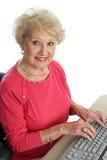 Beautiful Senior At Computer Stock Photo