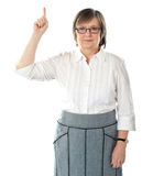 Beautiful senior business lady pointing upwards Stock Photography