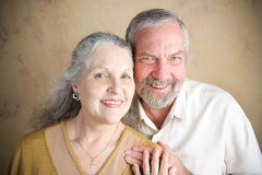 Beautiful Senior Couple - Christianity. Beautiful senior Christian couple.  She is wearing a cross and wedding.  Portrait illustrating traditional family values Royalty Free Stock Photography