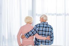 beautiful senior couple embracing in front stock image