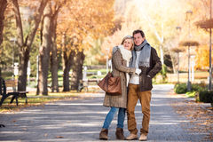 Beautiful senior couple hugging in park. Sunny autumn nature. Royalty Free Stock Photos