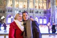 Beautiful senior couple ice skating in city centre. Winter Royalty Free Stock Photos